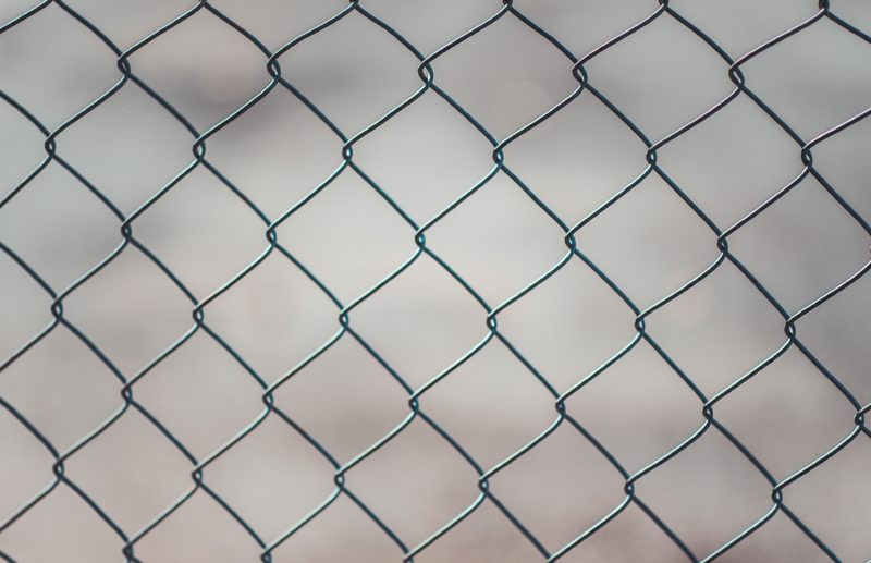 Close-up photo of a chain link fence