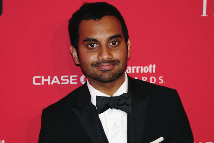 Aziz Ansari wearing a tuxedo at a red carpet event