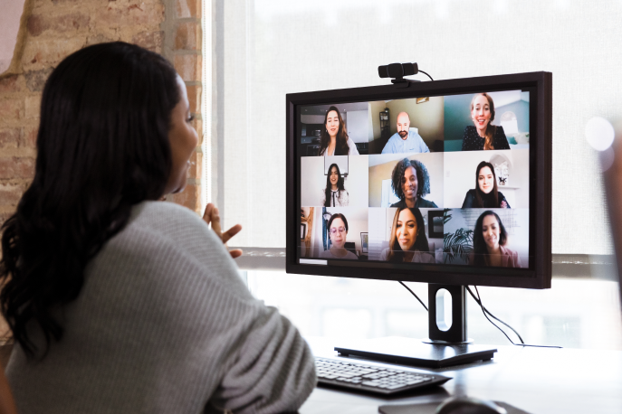Black woman on a video call with a diverse team