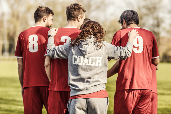 Soccer coach talking with team