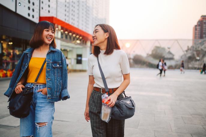 Two Asian American women walking down the street