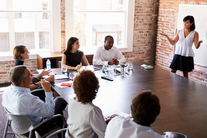 Woman giving a presentation in a boardroom